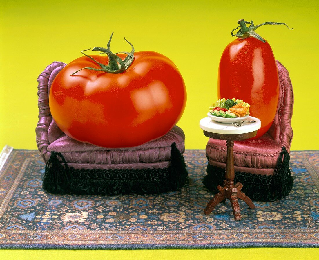 Fat and thin: two tomatoes on upholstered chairs