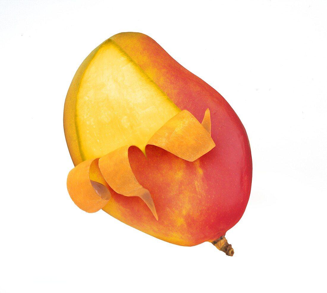 Mango, partly peeled