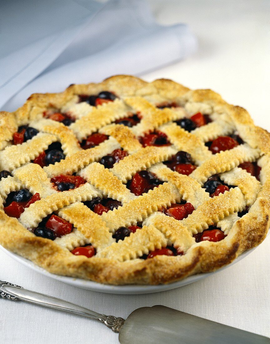 Strawberry and blueberry tart with pastry lattice