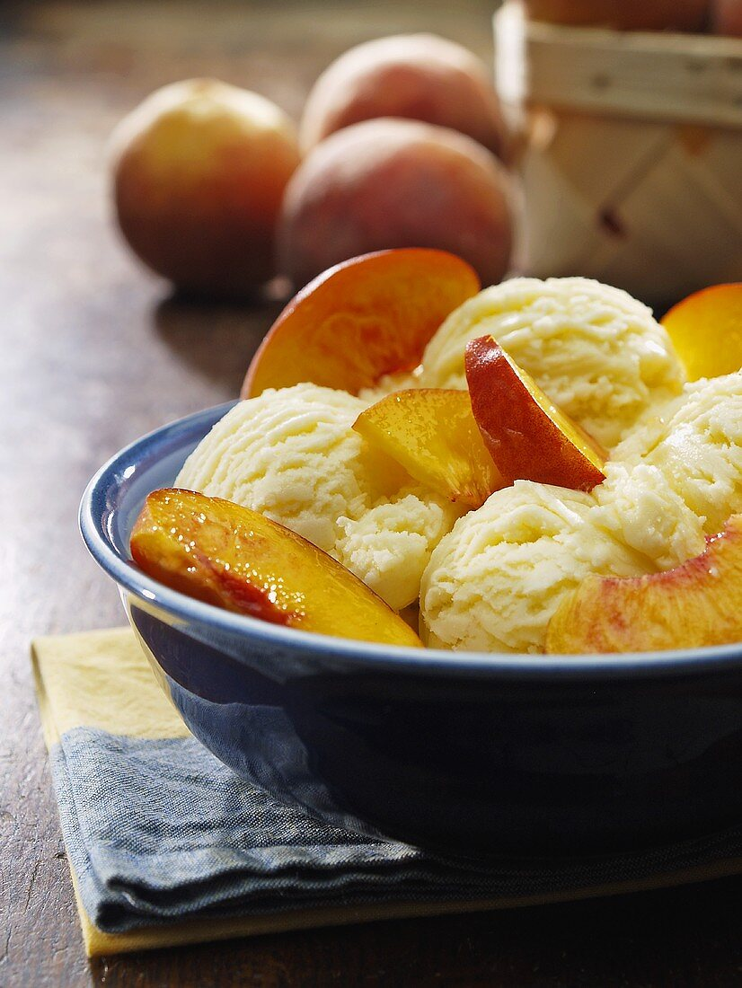 A Bowl of Vanilla Ice Cream with Peaches
