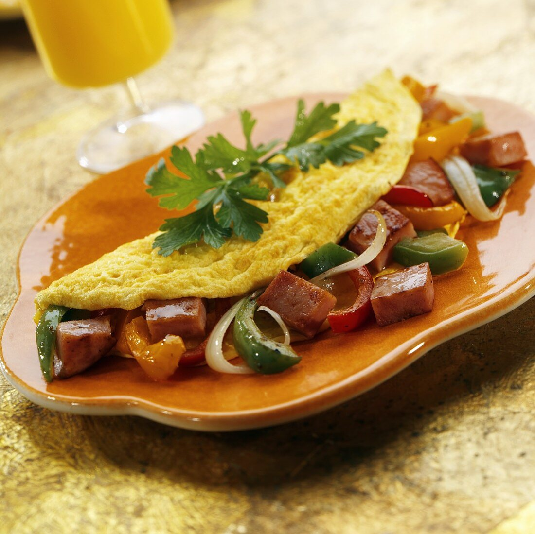 An Omelet with Ham, Bell Peppers and Onion
