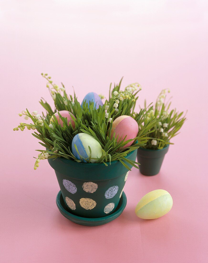 Colorful Easter Eggs in a Flower Pot with Grass