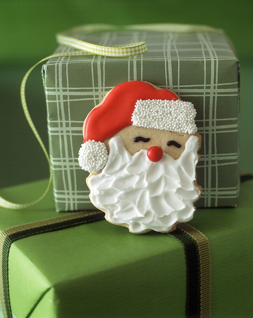 Father Christmas biscuit on gift boxes