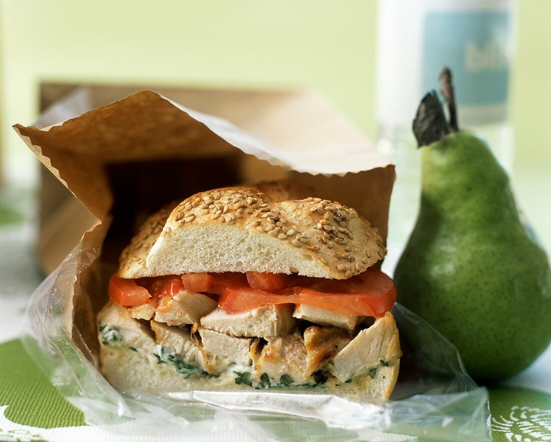 Brown Bag Lunch with Chicken Sandwich and a Pear