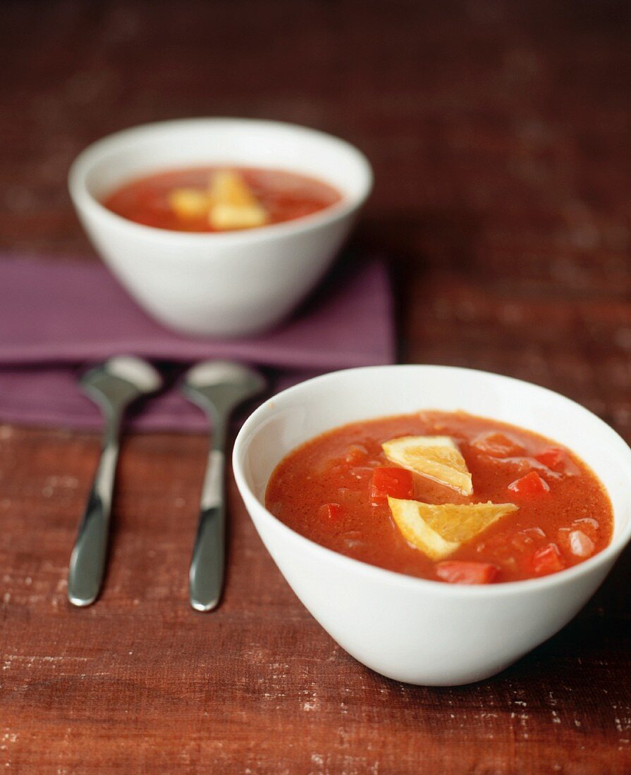 Tomato soup with orange wedges