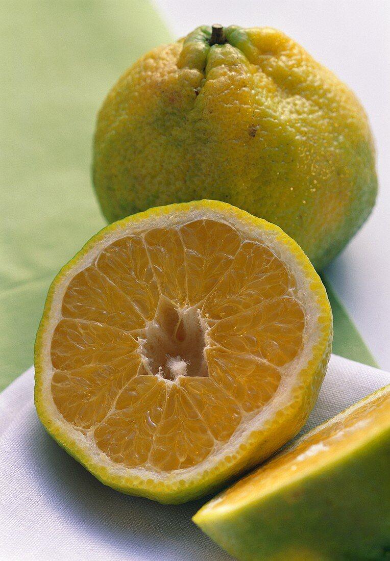 Ugli Fruit Cut in Half; Whole Ugli Fruit