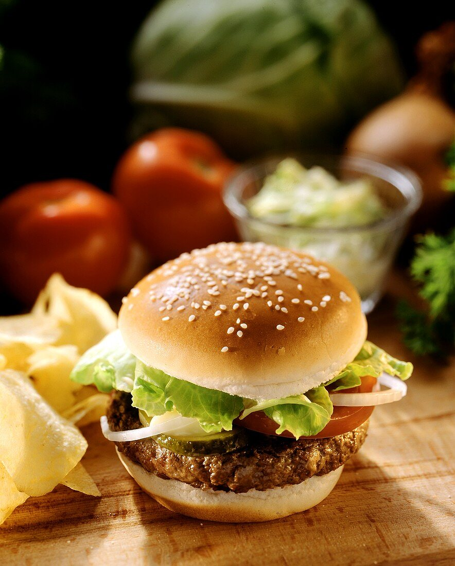 Hamburger with Lettuce Onions and Tomato on a Sesame Seed Bun