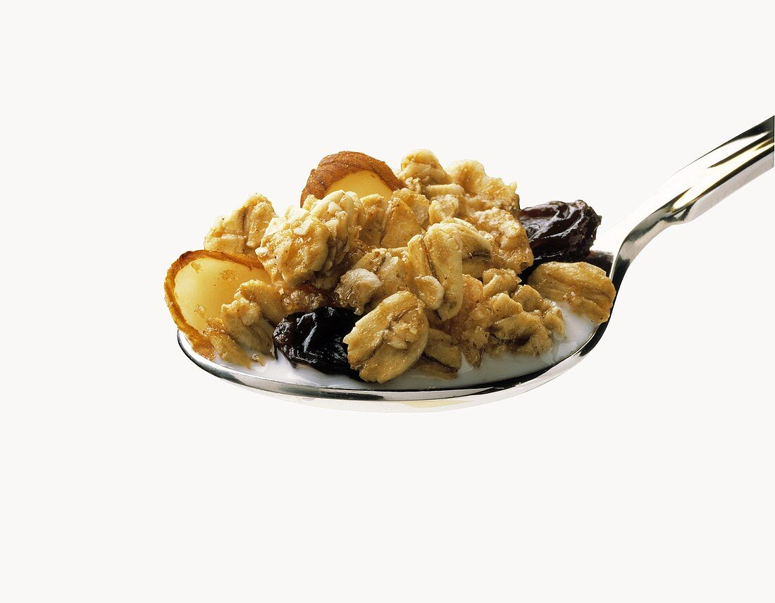 A Spoonful of Granola with Raisins and Almond Slivers