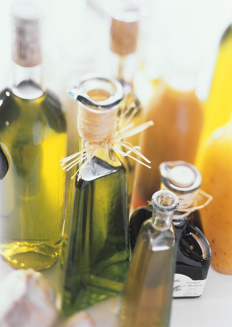 Assorted Oils and Vinegars in Bottles