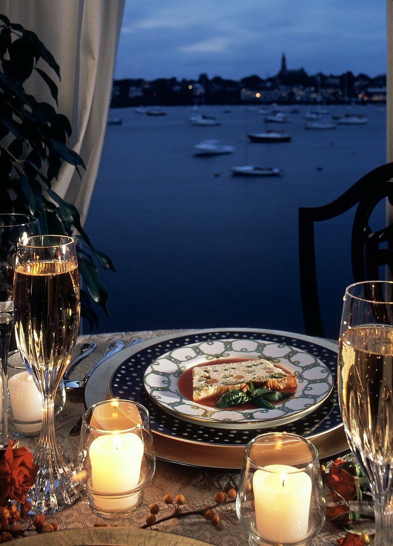 Seafood Terrine on a Table; Harbor in the Background