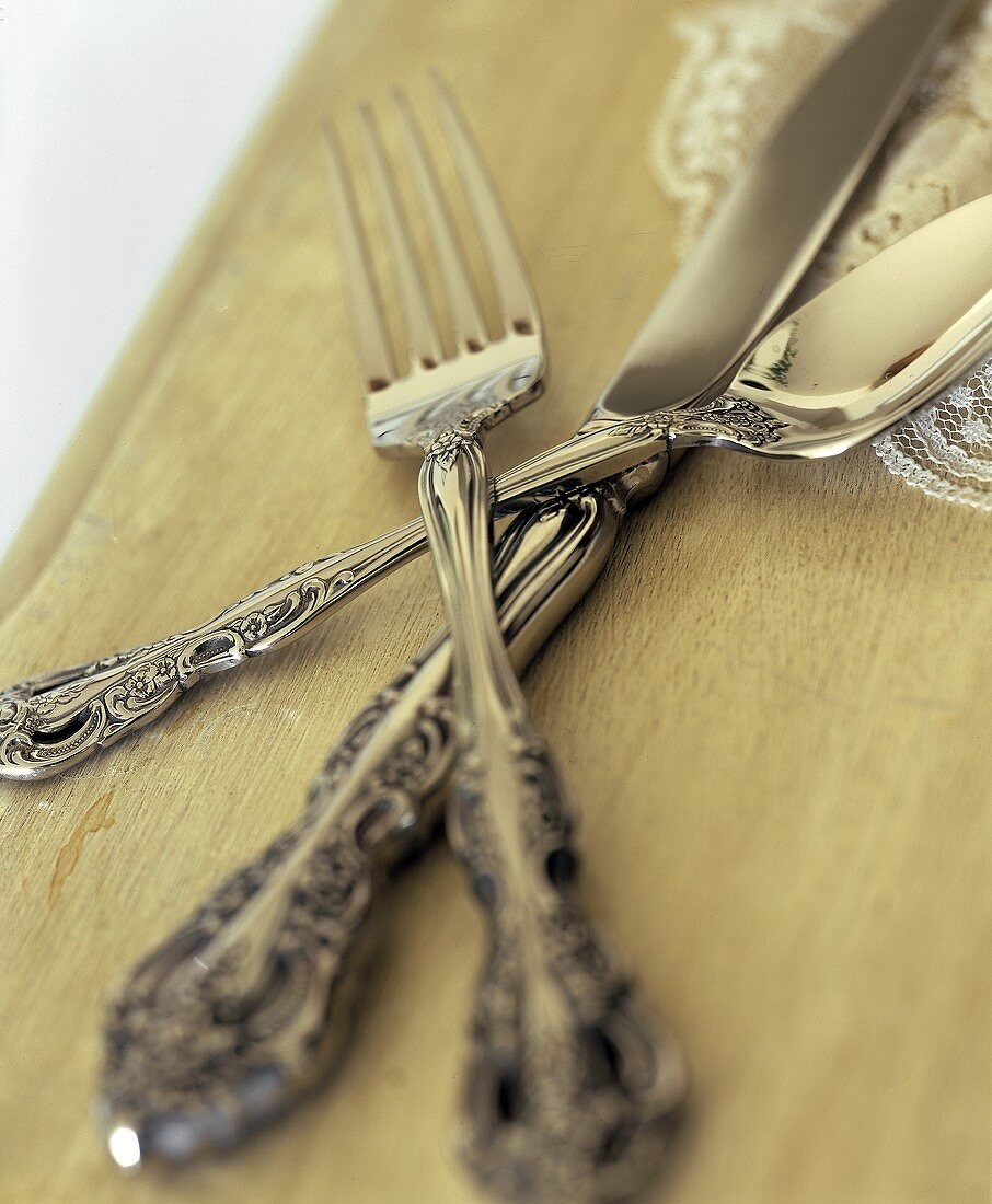 Antique Silverware; Stacked Knife, Spoon and Fork