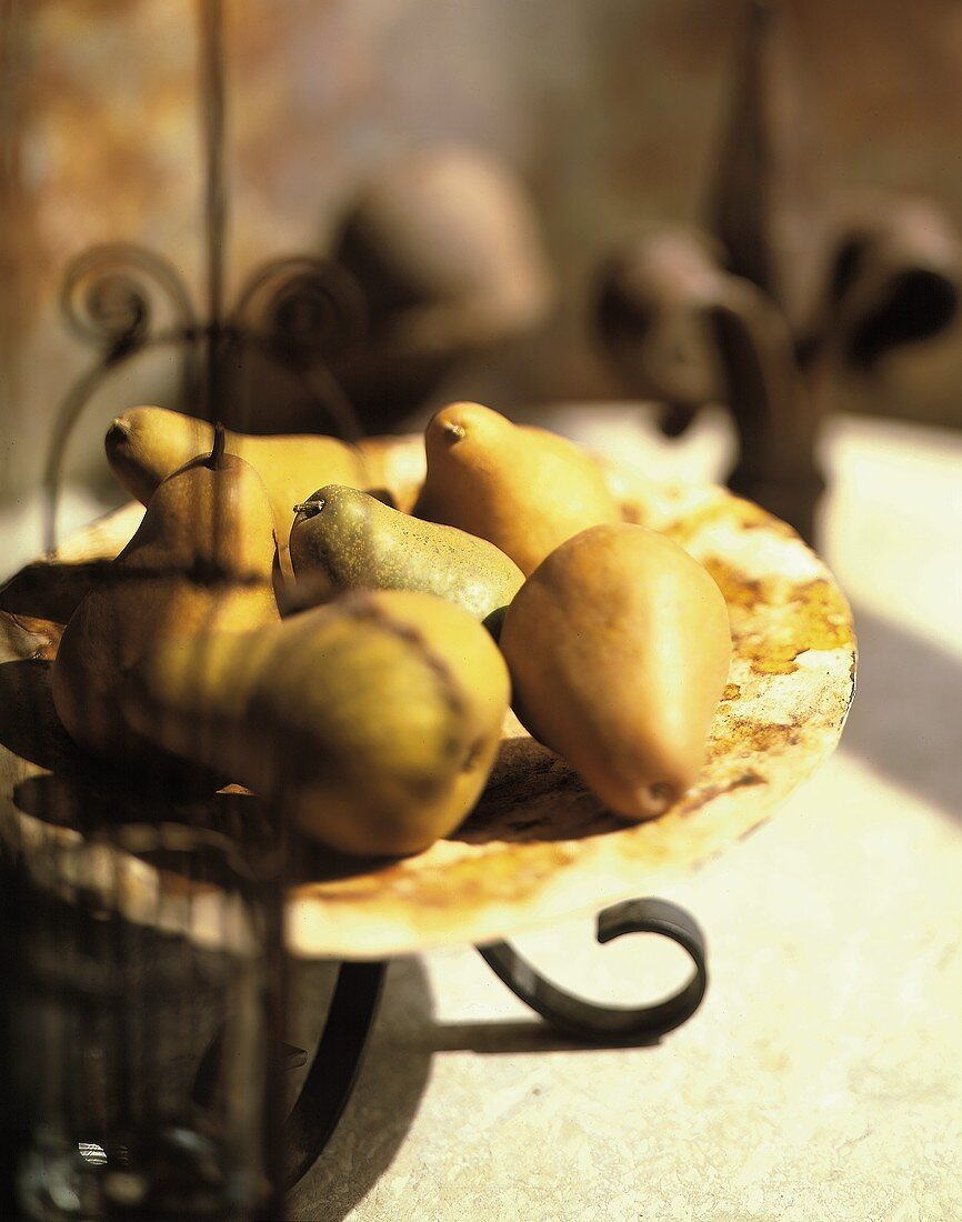 Several Bosc Pears on a Plate