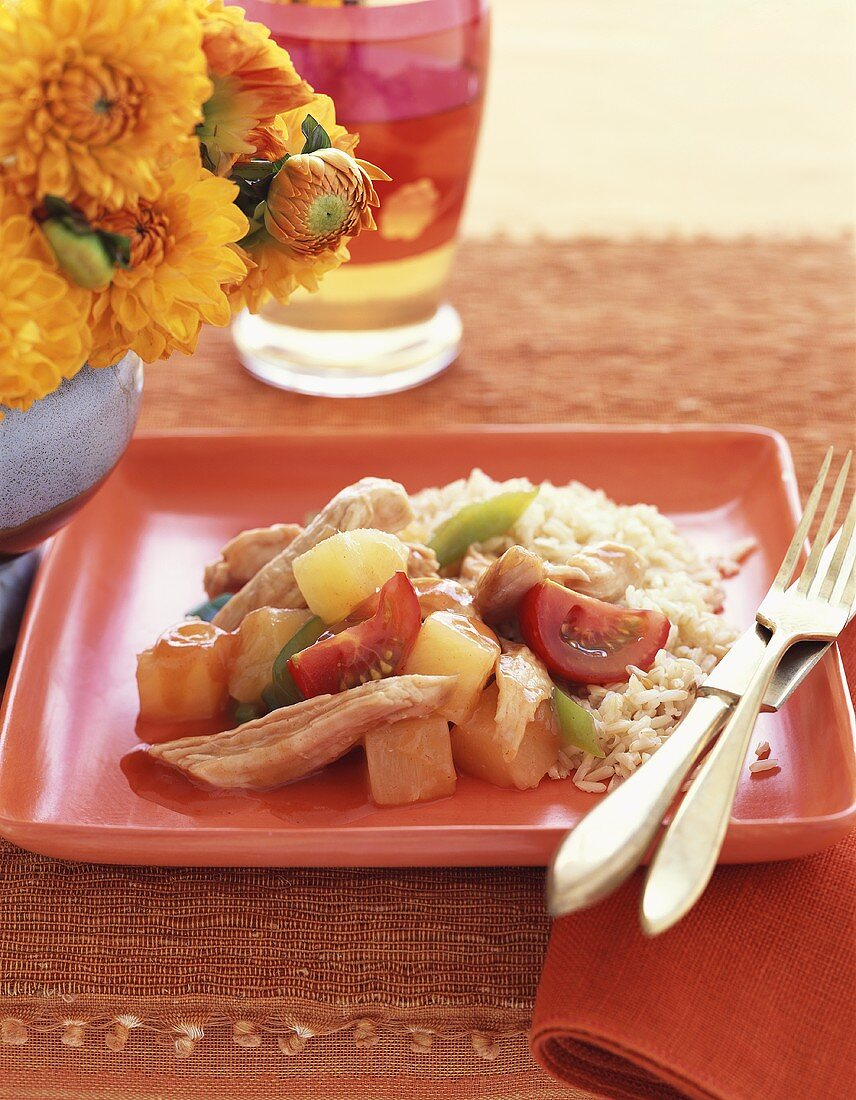Sweet and sour chicken with pineapple, vegetables and rice