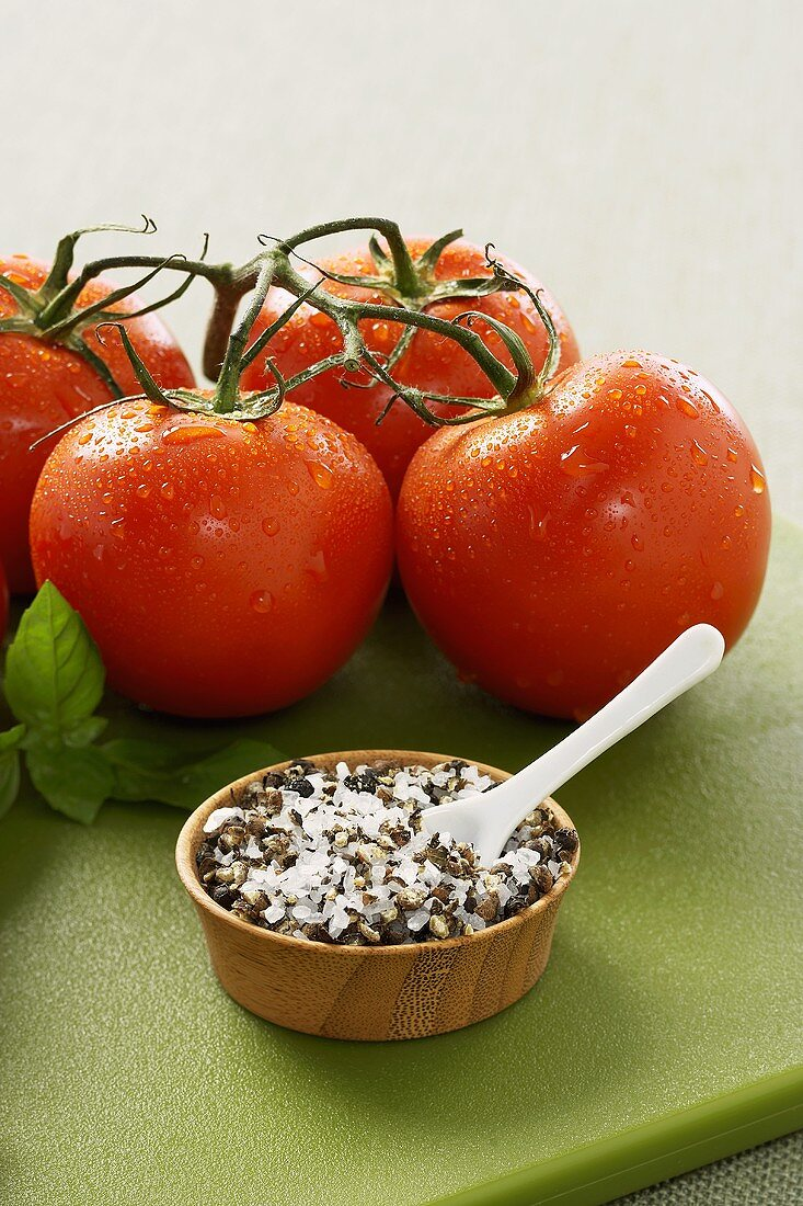 Small Bowl of Spice Mixture with Freshly Washed Tomatoes and Basil
