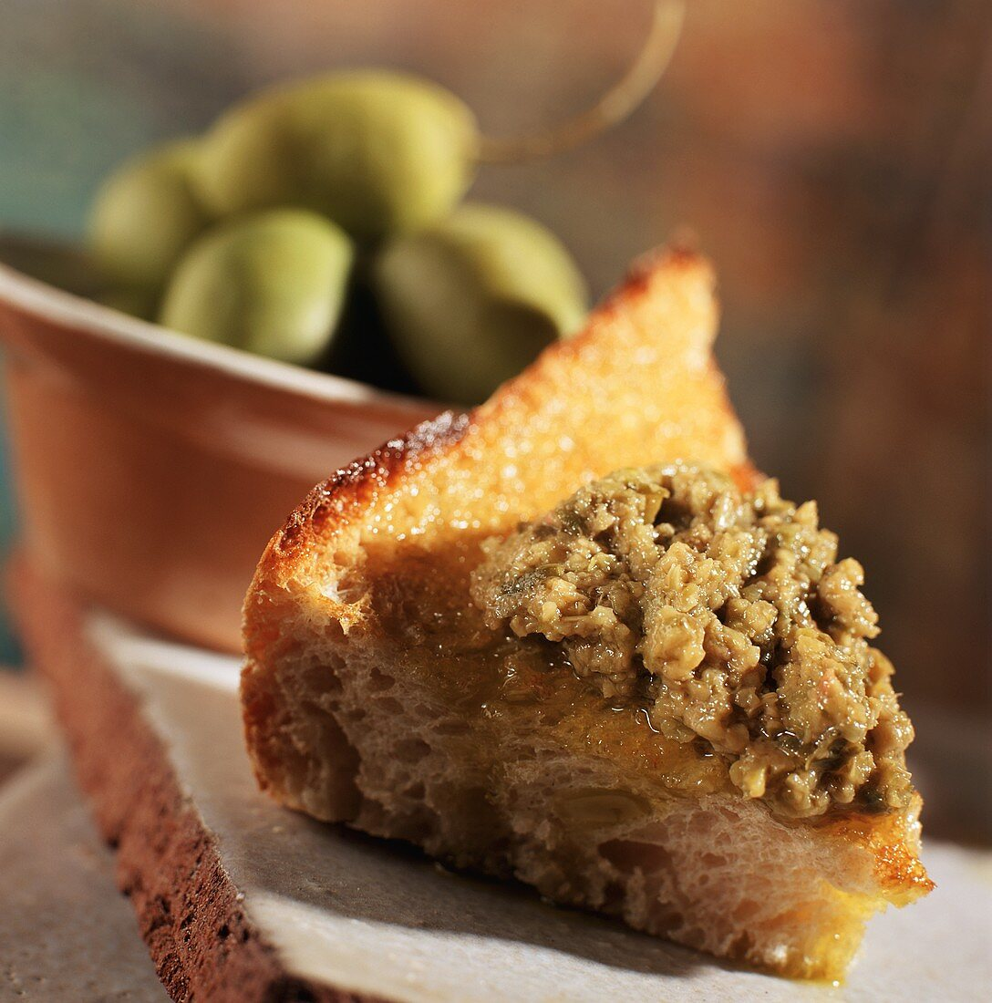 Green Olive Tapenade on a Piece of Bread