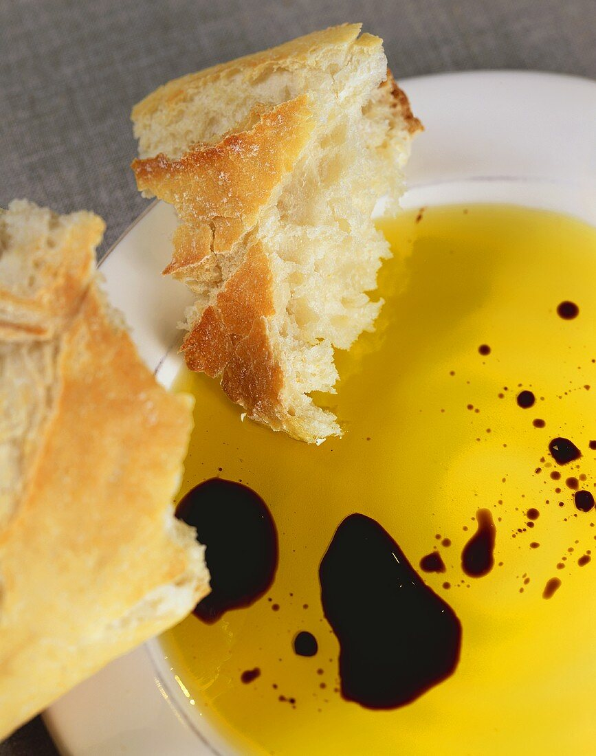 Bread with a Bowl of Olive Oil and Drops of Balsamic Vinegar