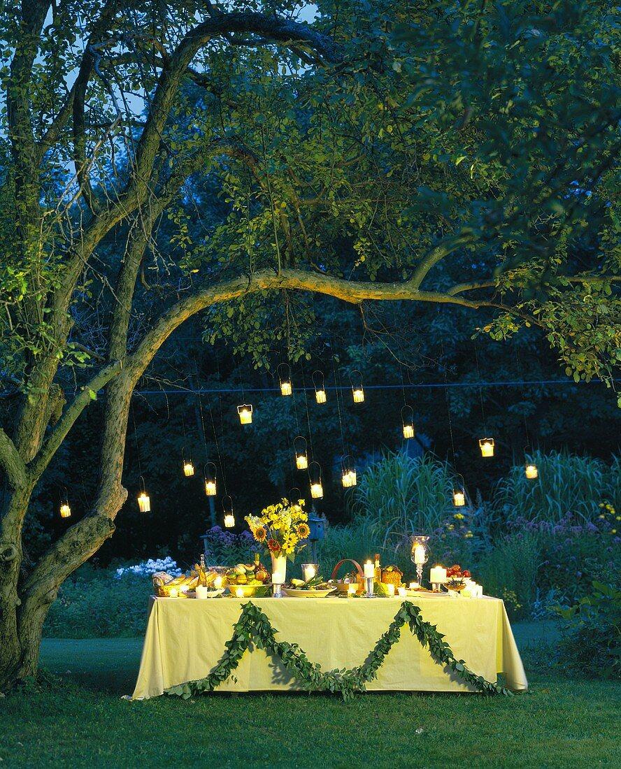 Summer buffet in candlelit garden