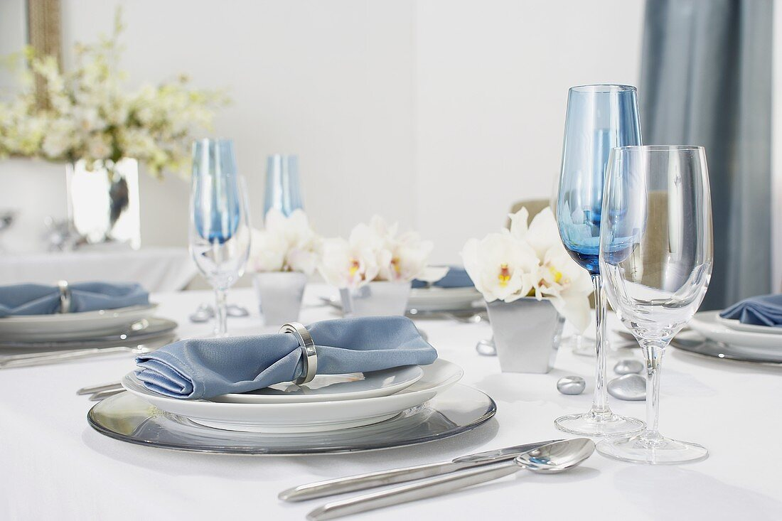 Place Settings with Blue Cloth Napkins on a Hanukkah Dining Table