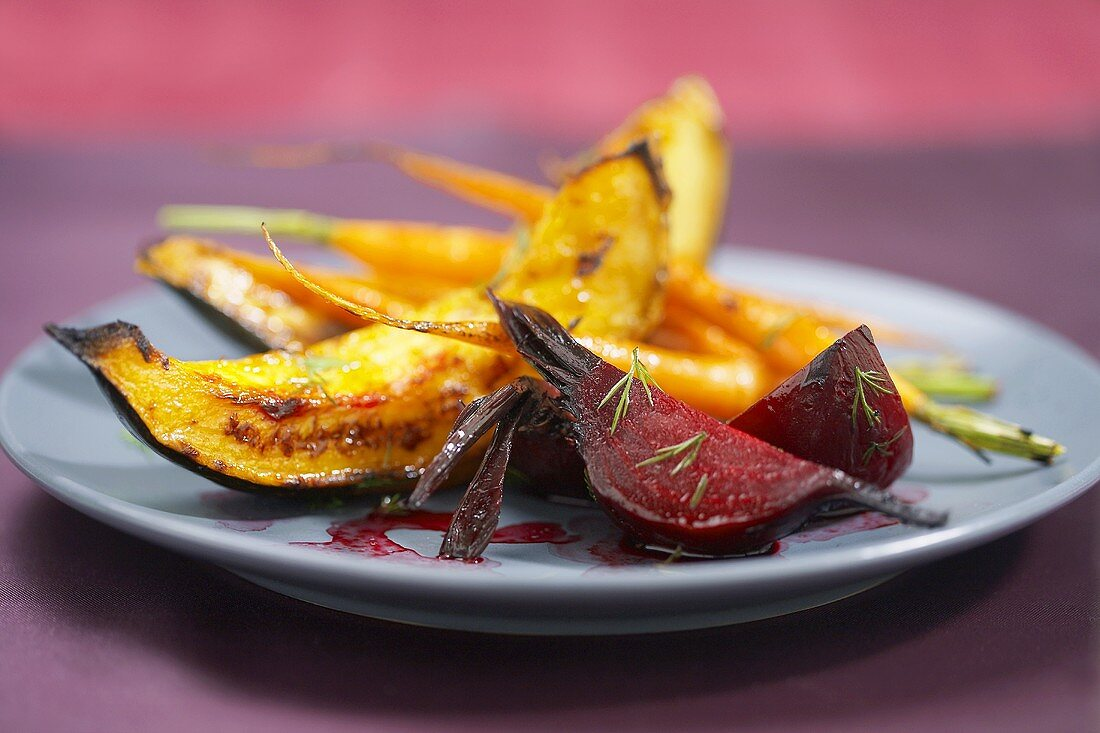 Plate with Wedges of Roasted Beets and Squash and Carrots