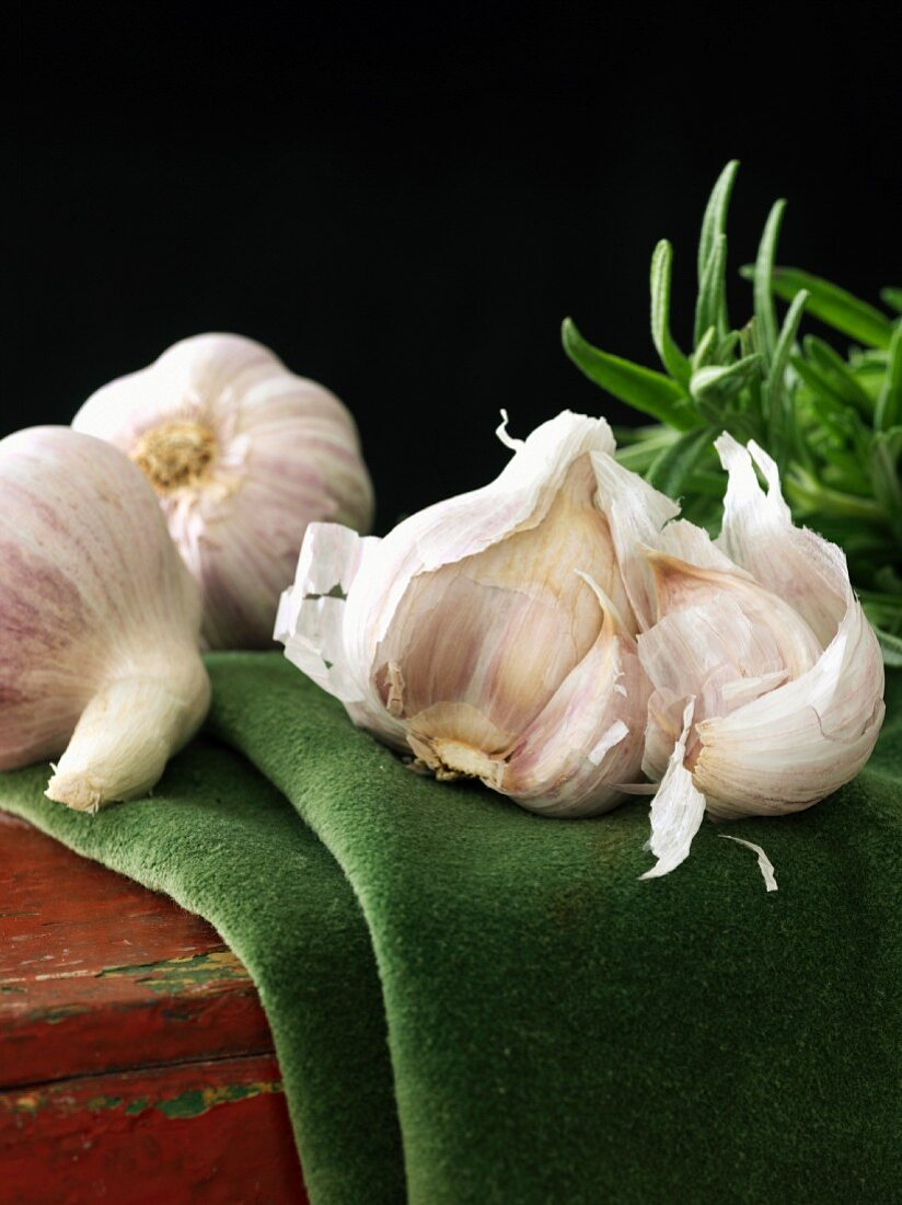 Whole Garlic Bulbs with a Garlic Bulb with Cloves Removed