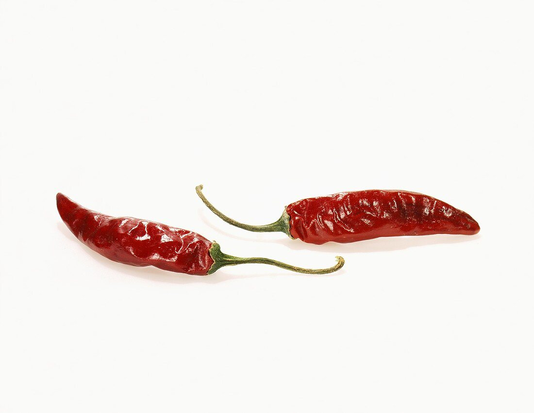 Two Red Chili Peppers on a White Background