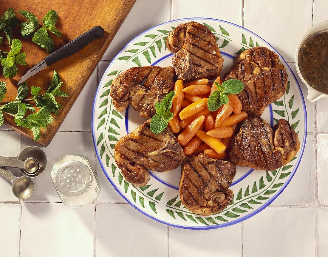 Grilled Lamb Chops on a Platter with Baby Carrots