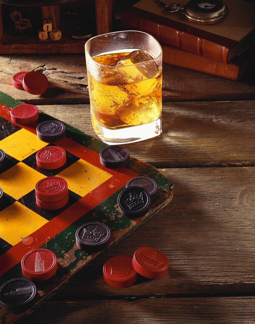 Glass of Scotch on the Rocks with a Game of Checkers