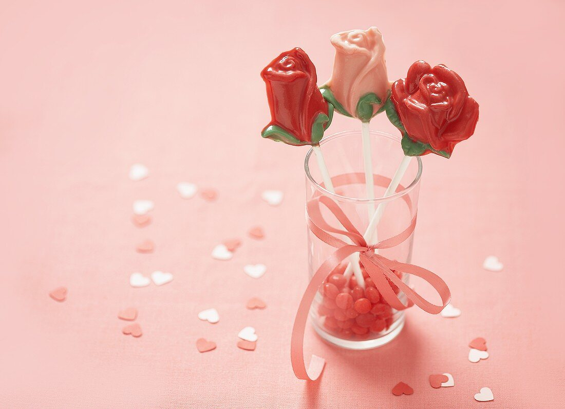 Three Chocolate Rose Pops on a Glass with Pink Candy and Ribbon