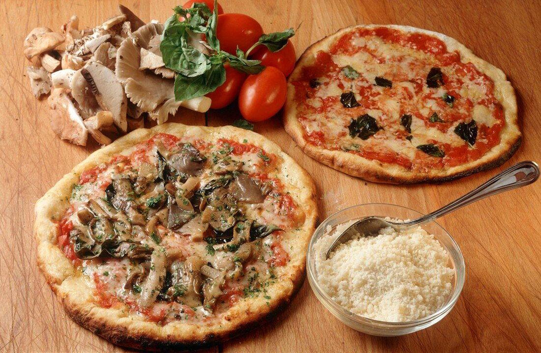 Two Pizzas Cooked in Brick Oven with Assorted Toppings