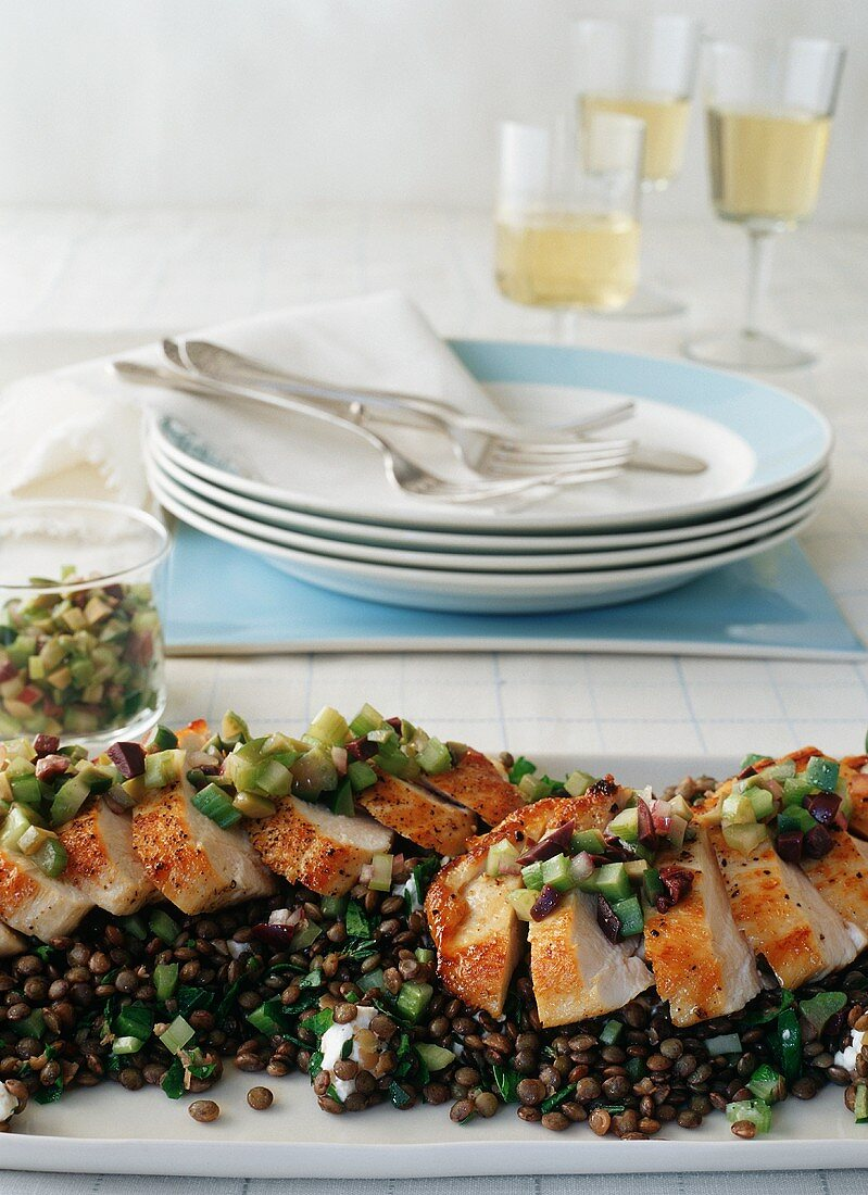 Sliced Pan Seared Chicken Breasts With Olive Relish on Warm Lentil Salad