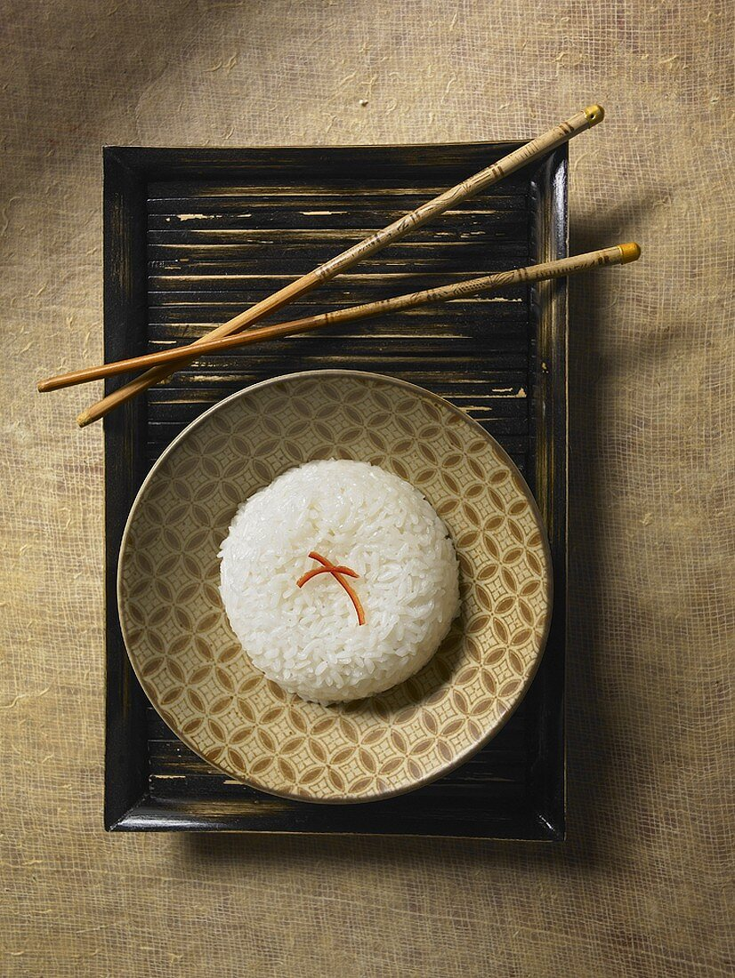 Bowl of Jasmine Rice on a Bamboo Tray with Chopsticks