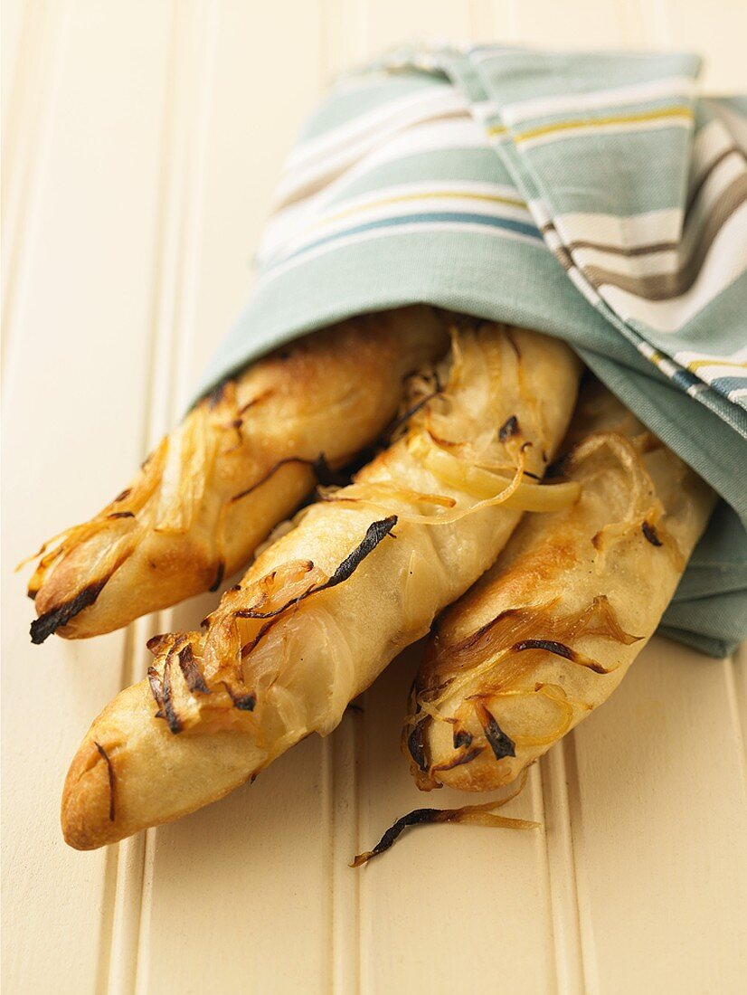 Loaves of Onion Bread Wrapped in a Towel