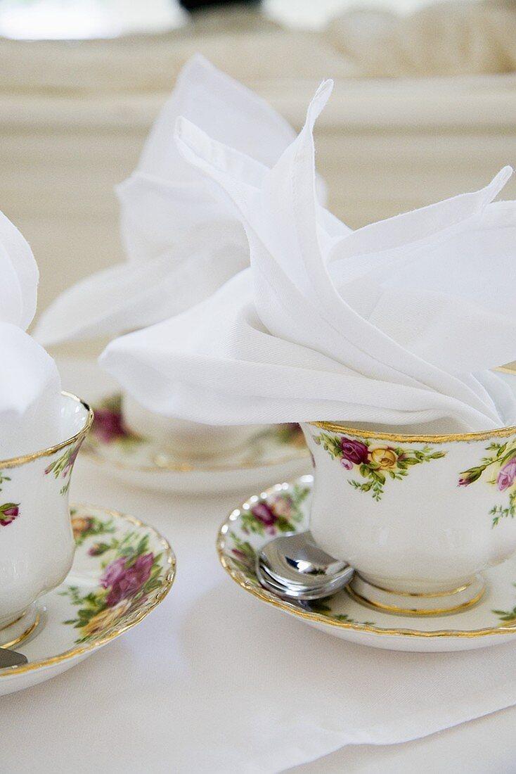 Porcelain Tea Cups Laid Out on a Buffet Table for High Tea