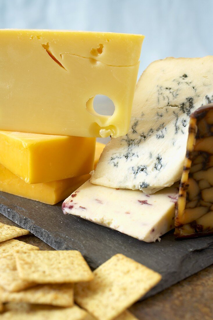 A Variety of Cheeses on a Slate Cheese Board with Crackers