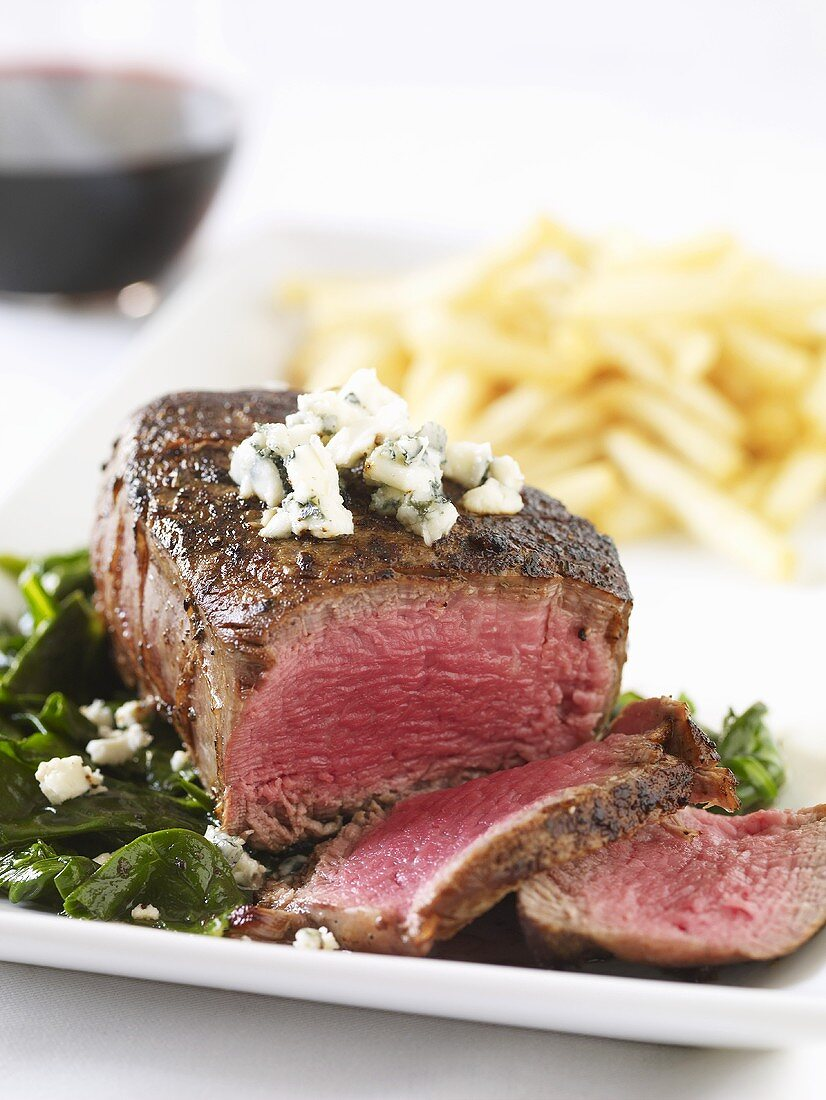 Filet mignon on leafy vegetables with Gorgonzola