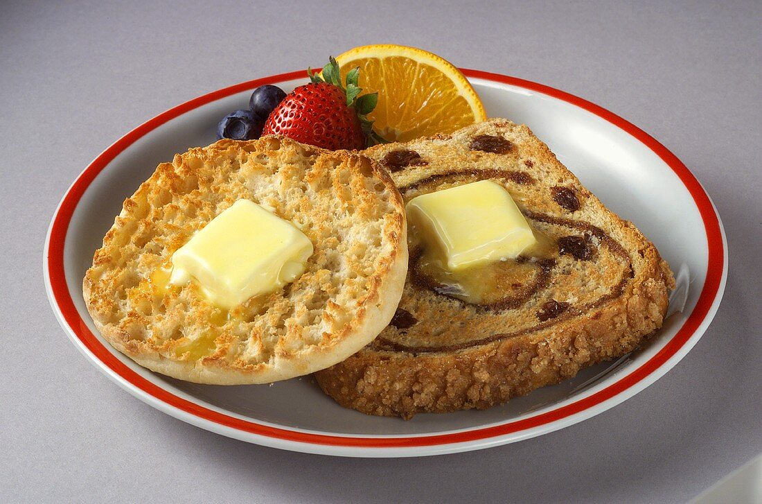 Half of an English Muffin and a Slice of Cinnamon Raisin Toast with Butter