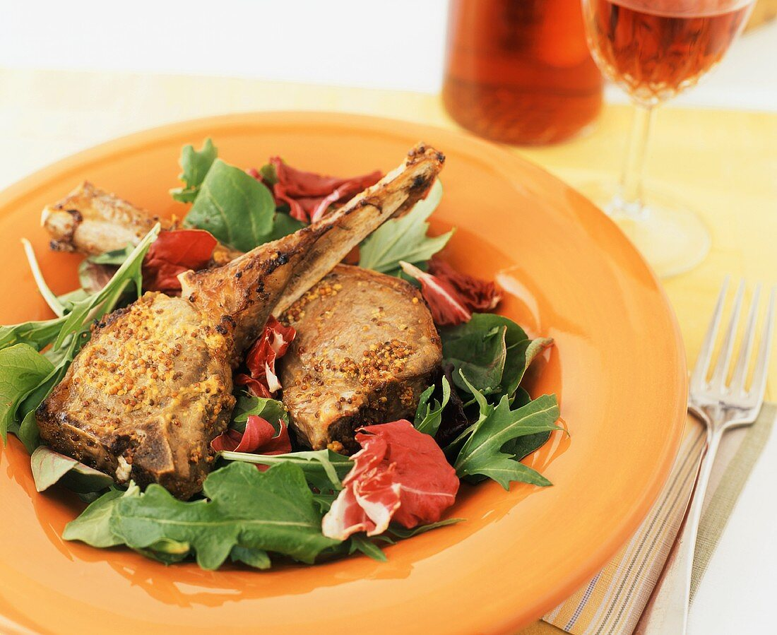 Broiled Lamb Chops with Garlic Mustard on a Bed of Greens