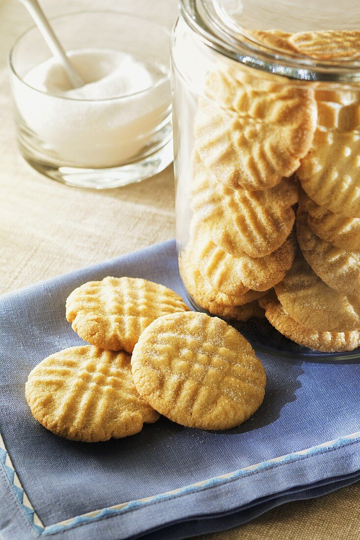 Sugar Cookies on a Napkin and in a Glass Cookie Jar