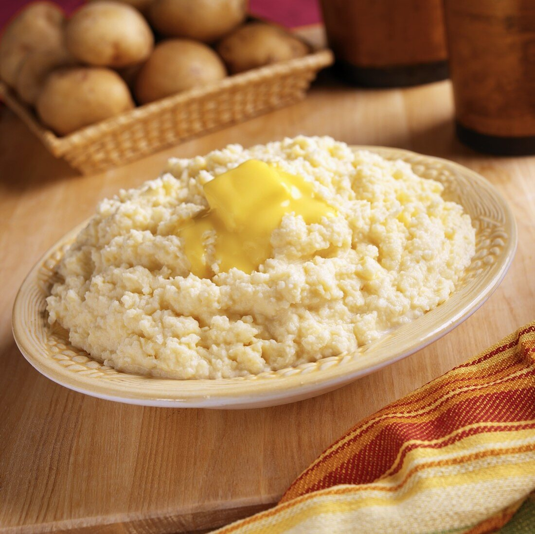 Mashed Yukon Gold potatoes with piece of melting butter