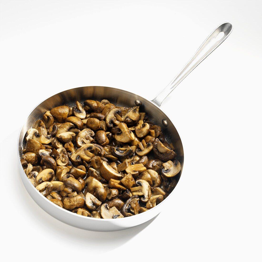 Stewed mushrooms in frying pan