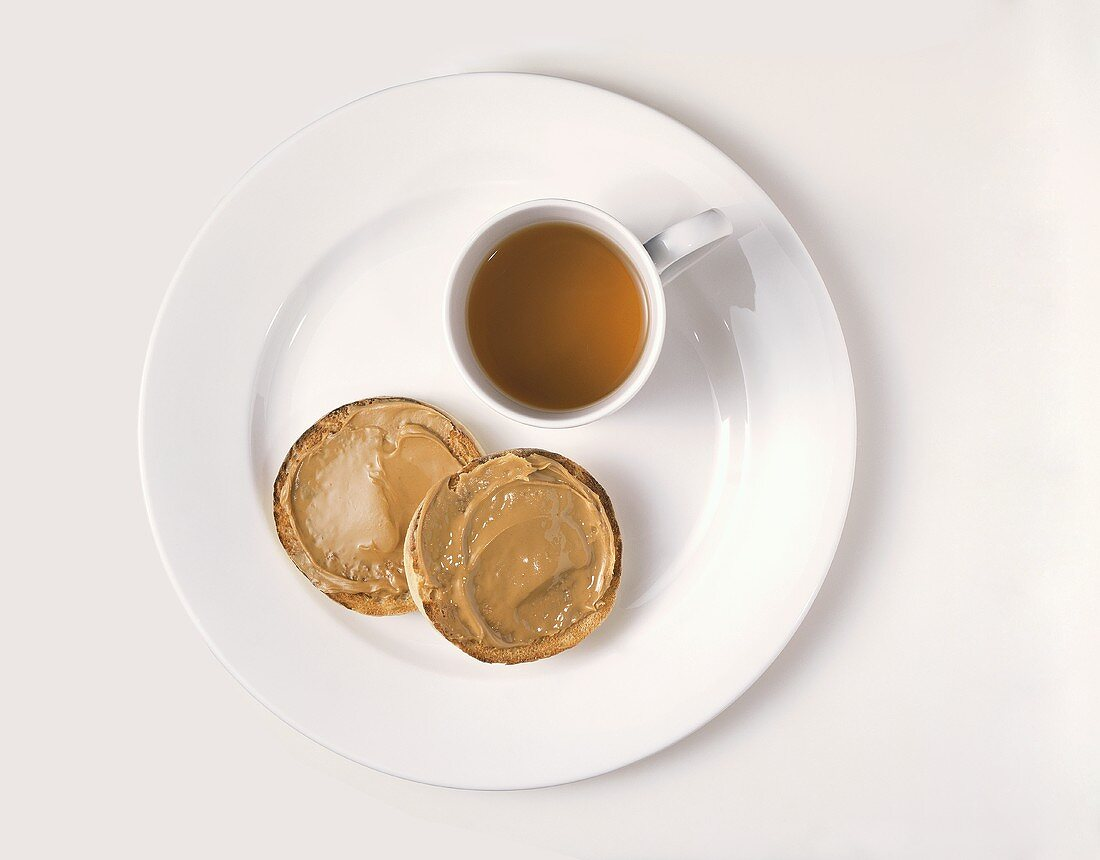 English Muffin with Peanut Butter and a Cup of Tea