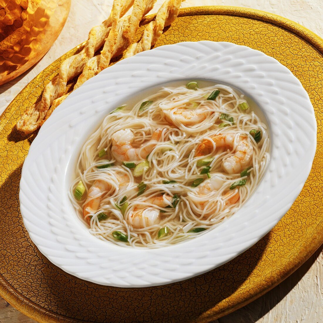 A Bowl of Angel Hair and Shrimp Soup with Cheese Bread Sticks