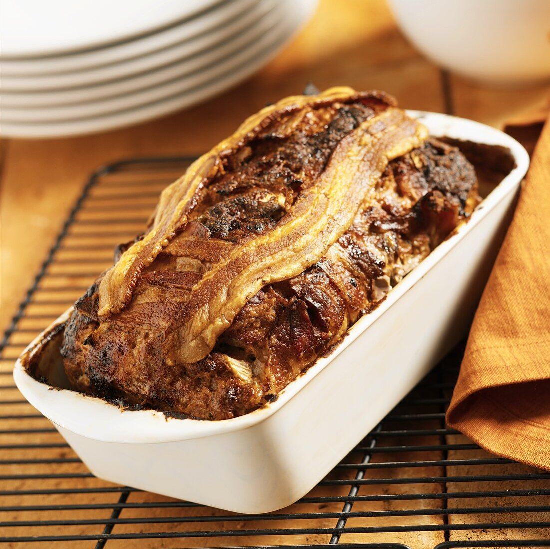 Meatloaf Topped with Bacon in a Ceramic Loaf Pan