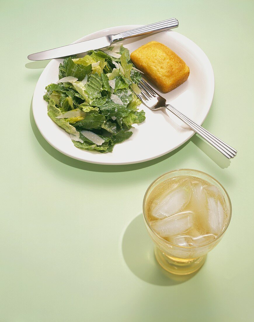 Caesar Salad on a Plate with Cornbread and a Ginger Ale