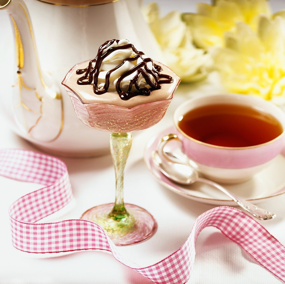 Chocolate Fudge Mousse in a Stem Glass with a Cup of Tea