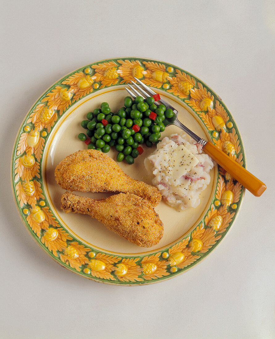 Fried Chicken Legs with Mashed Red Potatoes and Butter and Peas