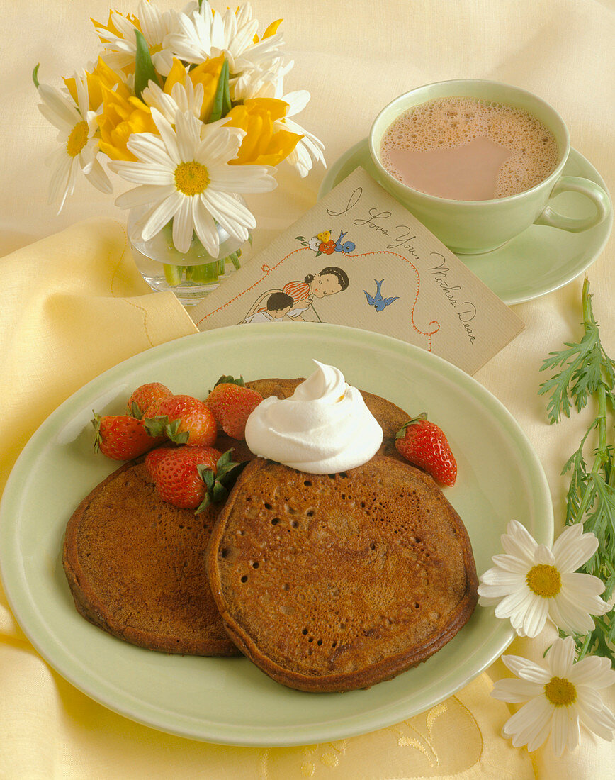 Chocolate Pancakes for Mother's Day with Whipped Cream and Strawberries
