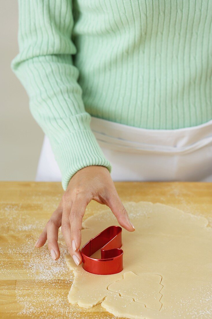 Pressing a Cookie Cutter into Dough