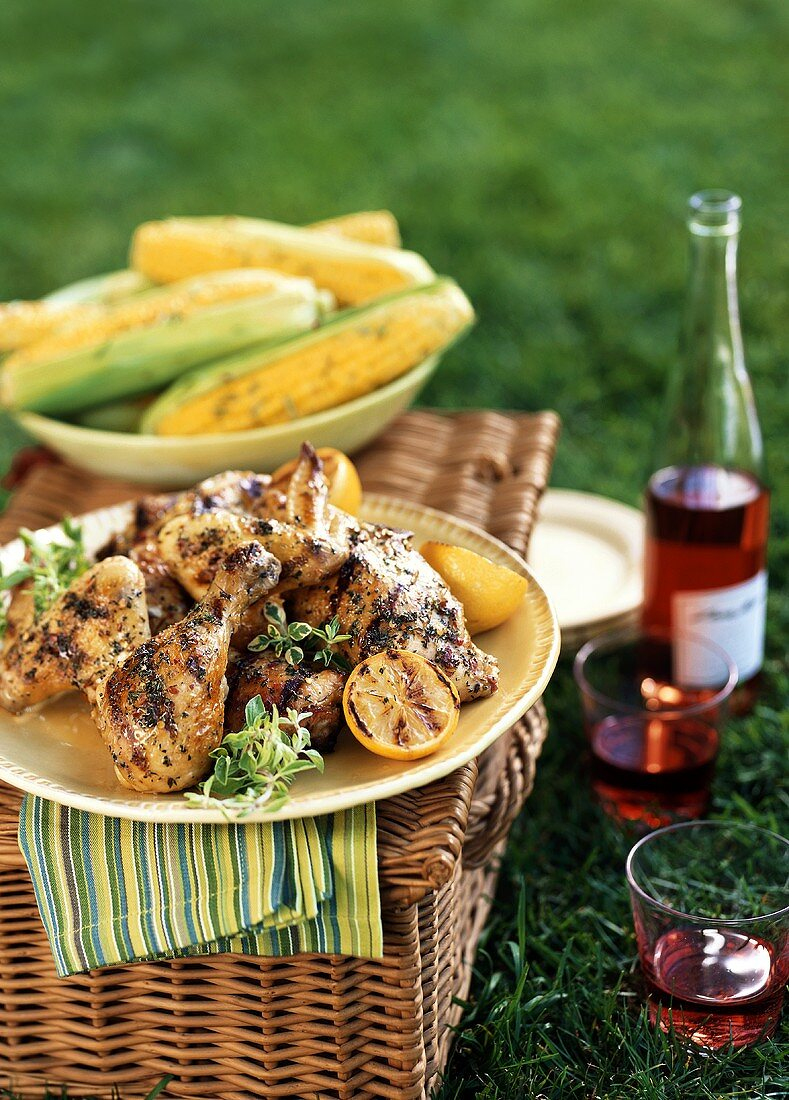 Grilled Chicken on a Picnic Basket with Corn and Wine