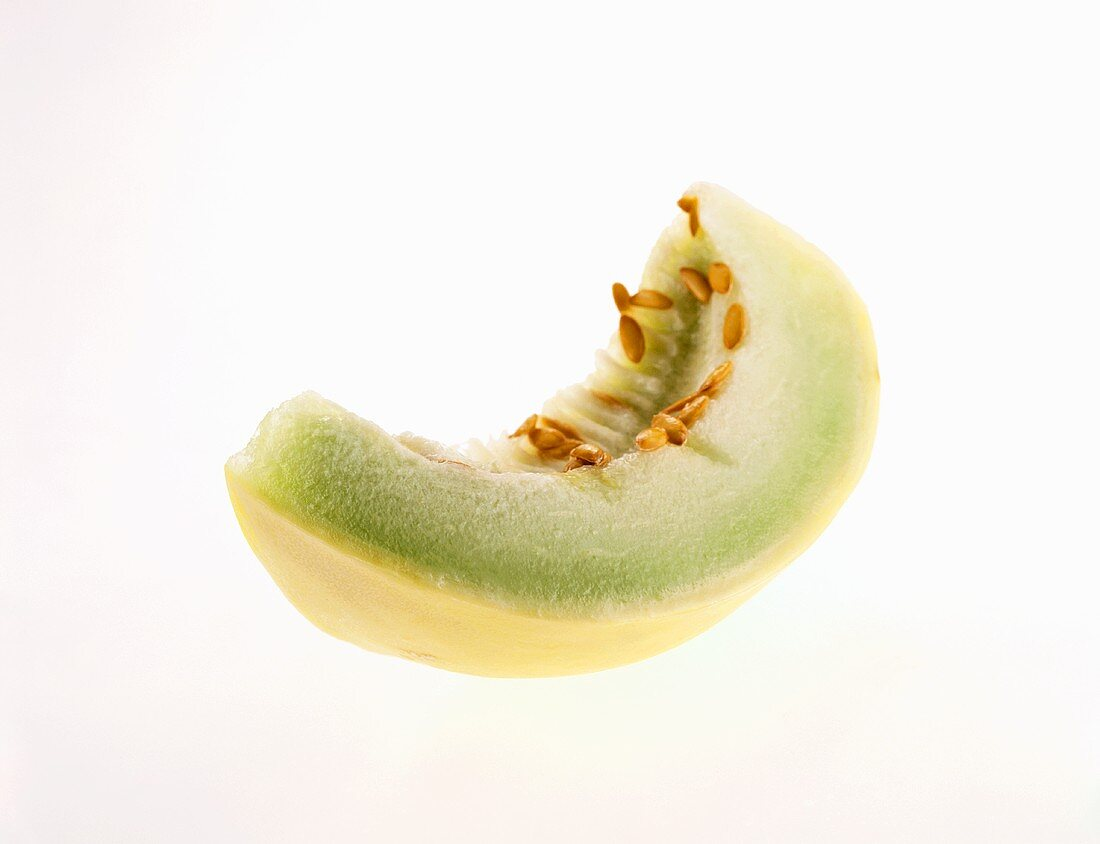 A Slice of Honeydew Melon with Seeds